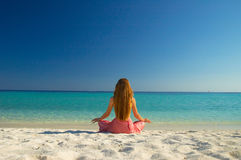 Meditation. Woman meditating on the beach Royalty Free Stock Photography