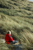 Meditation. Woman relaxing in the dunes stock photos