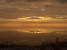 Meditation. Sunrise on Kremenchug's reservoir stock photography