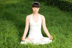 Meditation. A asian Chinese girl doing yoga exericise outdoors Stock Images