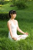 Meditation. A asian Chinese girl doing yoga exericise outdoors Stock Photo