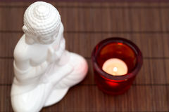 Meditation from above. White figure in meditation pose with candle in red glass from above royalty free stock images