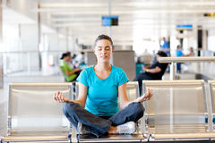 Meditation at airport royalty free stock photo