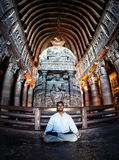 Meditation in Ajanta caves in India Stock Photos