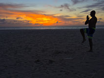 Meditation in Aruba. Semi-silhouette during a sunset meditation royalty free stock photography