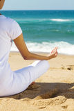 Meditation on beach Stock Image