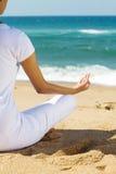 Meditation on beach Stock Image