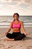 Meditation in the beach Stock Photos