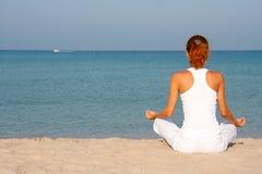 Meditation on the beach Stock Photography