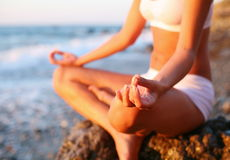 Meditation on the beach. Body of a beautiful girl in a meditation on the beach Royalty Free Stock Image