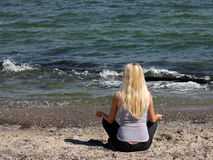 Meditation on the beach Stock Images