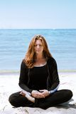 Meditation at the beach Stock Photo
