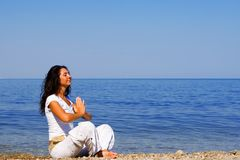 Meditation in the beach Stock Image