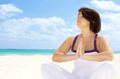 Meditation on the beach Royalty Free Stock Photos