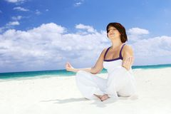 Meditation on the beach Stock Photos