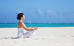 Meditation on the beach Stock Photography