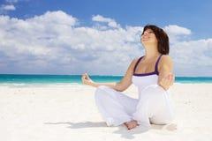 Meditation on the beach Stock Image