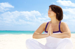 Meditation on the beach Royalty Free Stock Image
