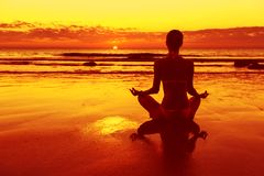 Meditation on the beach. At sunset Royalty Free Stock Photography