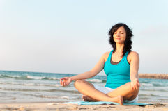 Meditation on the beach. Woman meditating on the beach Royalty Free Stock Photos
