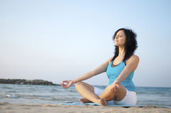 Meditation on the beach. Woman meditating on the beach Royalty Free Stock Photography