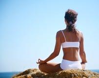 Meditation on the beach Stock Photos