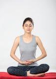 Meditation. Beautiful India Brunette doing Meditation royalty free stock images