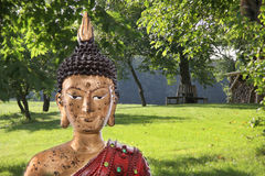 Meditation: Buddha figurine in a zen garden. Royalty Free Stock Images