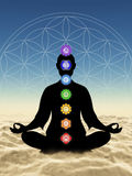 In meditation with chakras above clouds Stock Images
