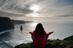 Meditation on the cliffs of moher Stock Photos