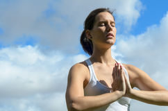 Meditation and Clouds Royalty Free Stock Photography