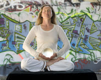 Meditation With Crystal Ball And Graffiti Stock Image