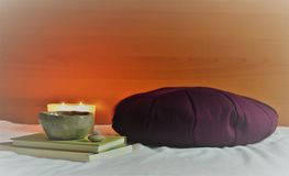 Meditation Cushion with Candle Light and books. Meditation Cushion with Candle Light at Home for Meditating Session Relaxing and Peaceful stock photos