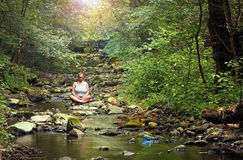 Meditation in deep forest stock photos