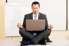 Meditation upon desk stock image