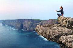 Meditation on the edge of a cliff. In Ireland Royalty Free Stock Images