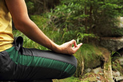 Meditation in forest. Man meditation in forest sitting in lotus position stock images