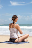 Meditation in front of ocean Stock Photos