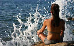 Meditation in front of the sea Stock Image