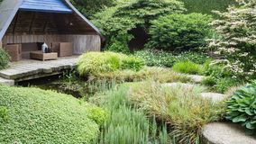 Meditation garden with rooftop. And stepping stones in the water royalty free stock photos