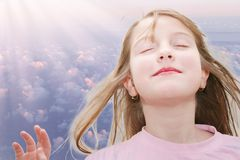 Meditation girl. A  photo with a smiling girl 8 years old Stock Photography