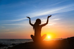 Meditation girl on the sea during sunset. Stock Images