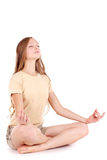 Meditation. Girl in sport's shirt. Meditation. Healthy girl in sport's shirt on isolated white background Royalty Free Stock Photo