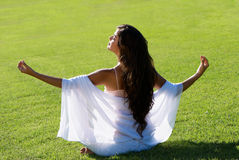 Meditation on a green field Stock Photography