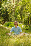 Meditation in green forest Royalty Free Stock Photos