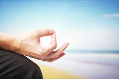 Meditation. Hand in meditation on a ocean background Stock Images