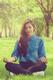 Meditation. She have a happy with meditating in park Royalty Free Stock Photography