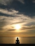 Meditation in Indonesia. A Young Woman Meditating on Sanur Beach, Indonesia Royalty Free Stock Photo