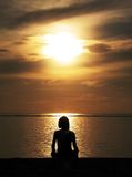 Meditation in Indonesia. A Young Woman Relaxing on Sanur Beach, Indonesia Stock Images