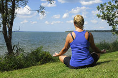 Meditation By the LAke Stock Images